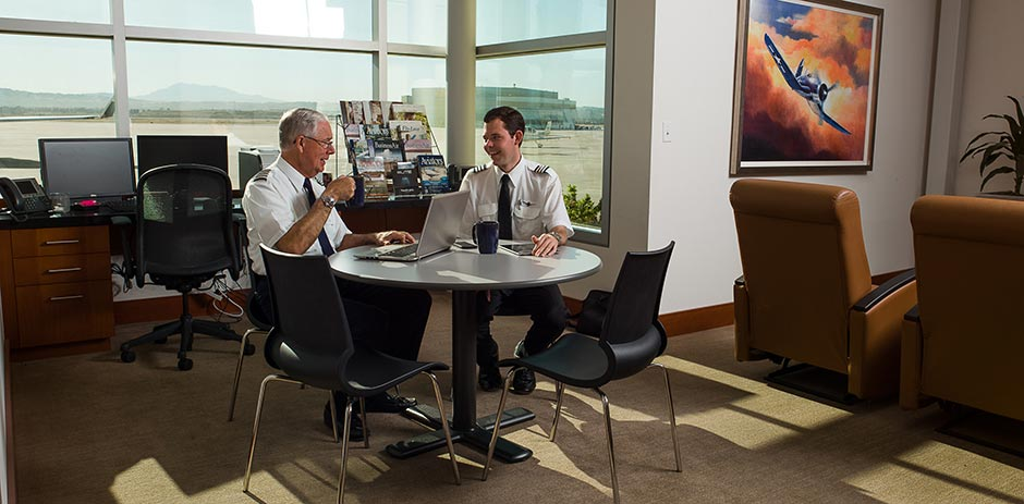 two pilots meeting in lounge