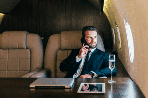 Businessman sitting in a private jet