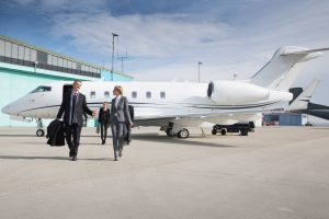 passengers exiting private jet